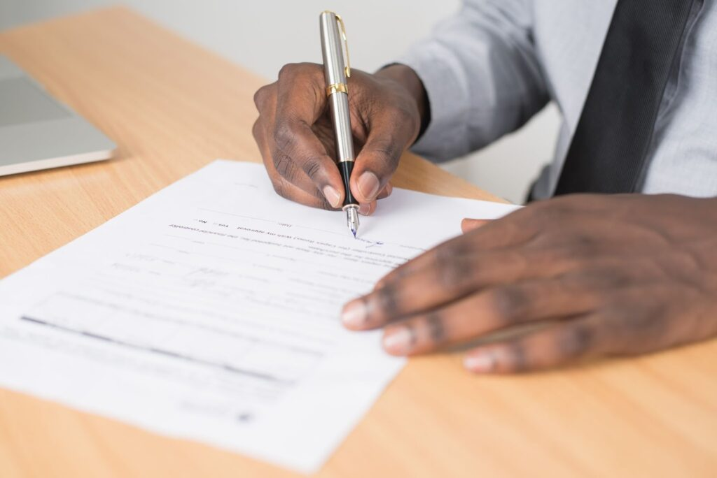 Signing the documents with the use of pen