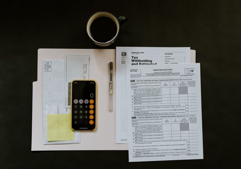 Tax paper documents with calculator beside