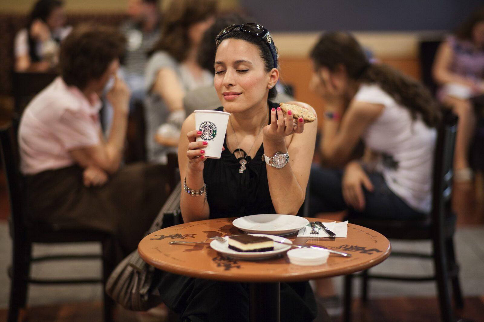 Woman drinks coffee in Starbucks